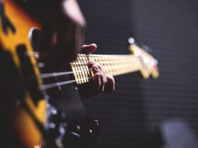 Stock image of close up of a burnt coloured bass guitar