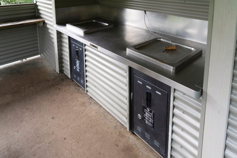 Two BBQs in cooking shelter.
