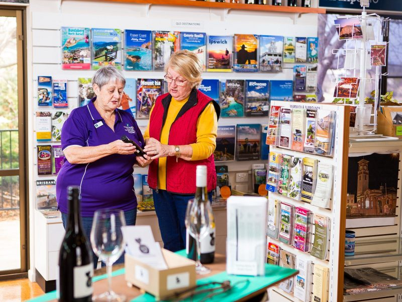 Lady helping a visitor in the Stanthorpe Visitor Info Centre