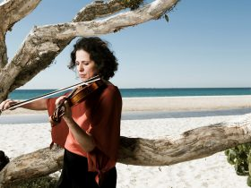 The festival's Artistic Director, Rachel Smith, on Home Beach, North Stradbroke Island