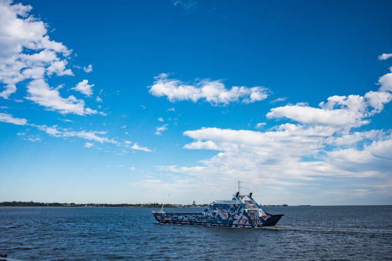 Minjerribah Vehicle Ferry crossing the bay
