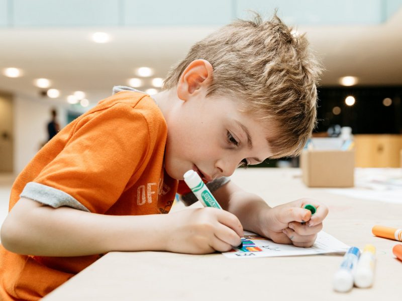 Child drawing at a workshop