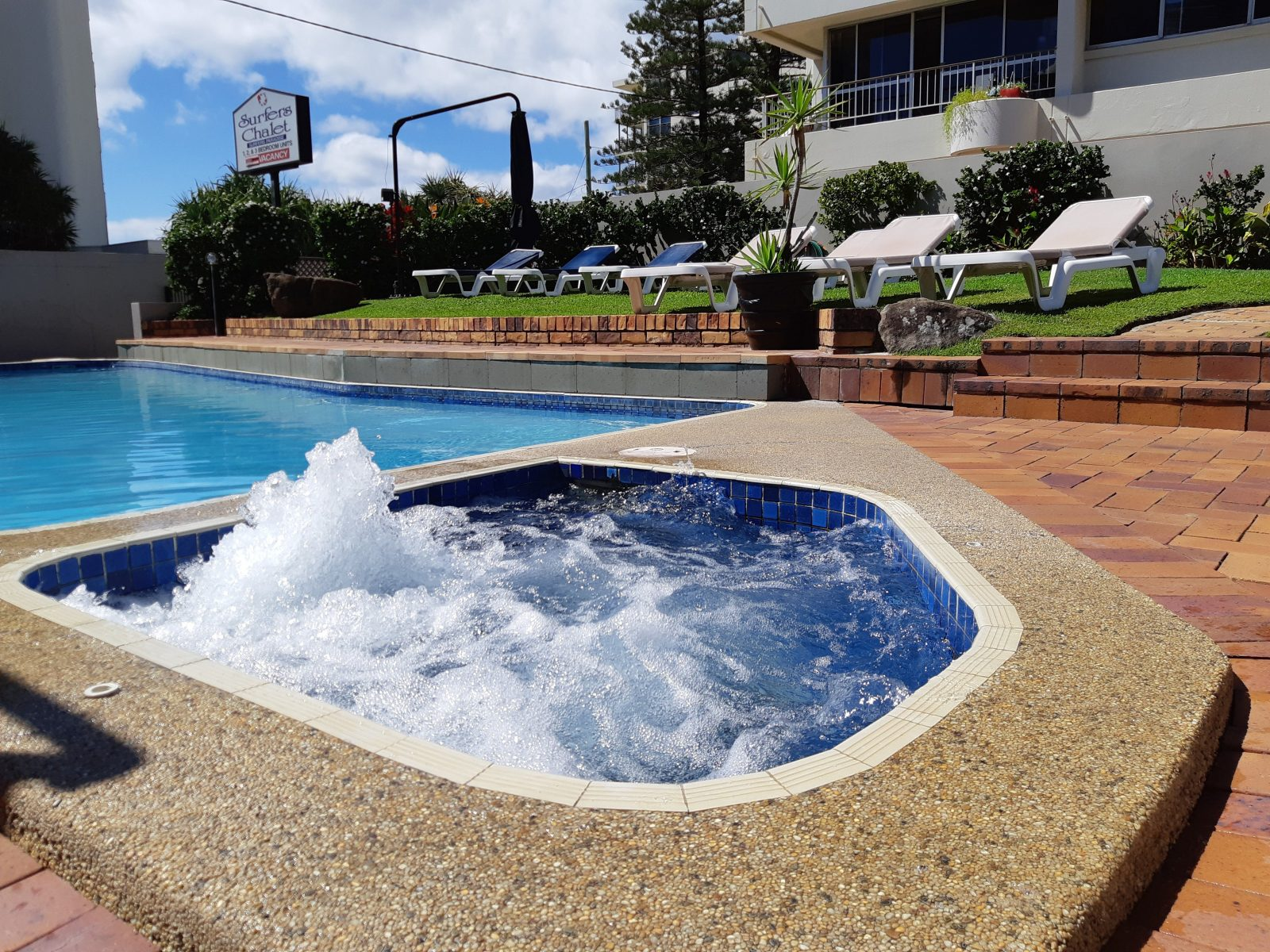 Unwind by the pool and heated spa