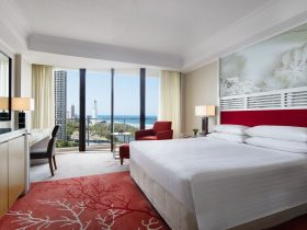 Enjoy plush bedding and ocean views in paradise.