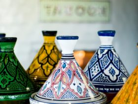 Classic hand painted Moroccan Tagines in front of The Taboon oven