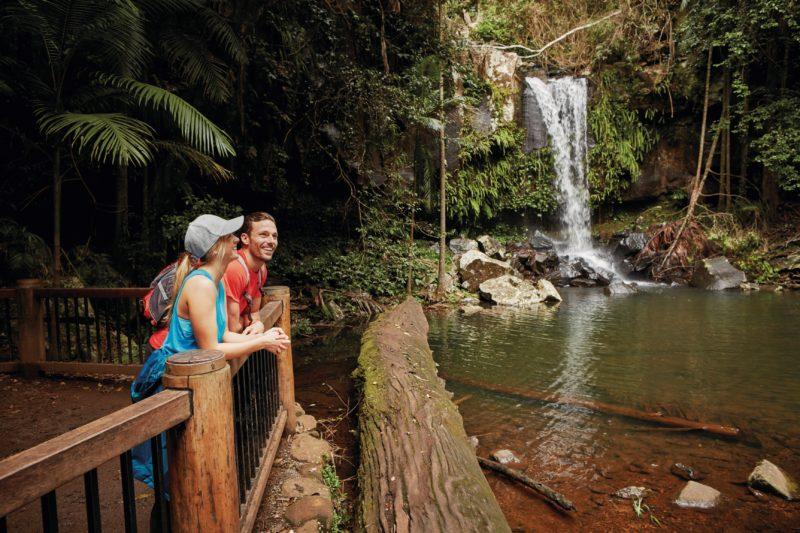 COUple looking at waterfalls, Tamborine National Park