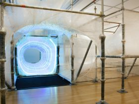 View of the Tapescape indoor landscape sculpture created with sticky tape over a scaffold support