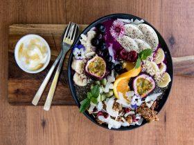 Bowl of seasonal fruit and yoghurt