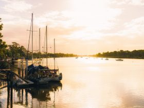 River sunset with boats on Burnett River Bundaberg