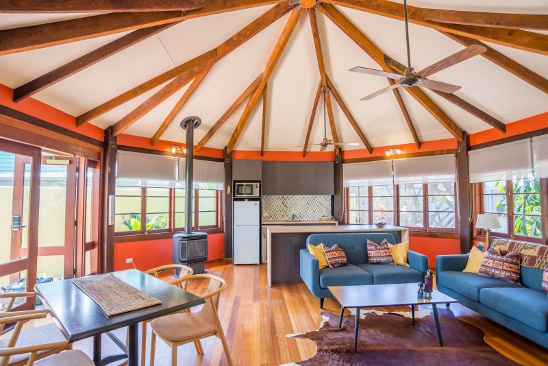 Interior photo showing the lounge of the Rowandel Cottage at The African Village - by Clouds, Maleny