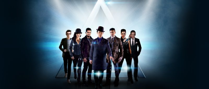 The Illusionists Standing On Stage