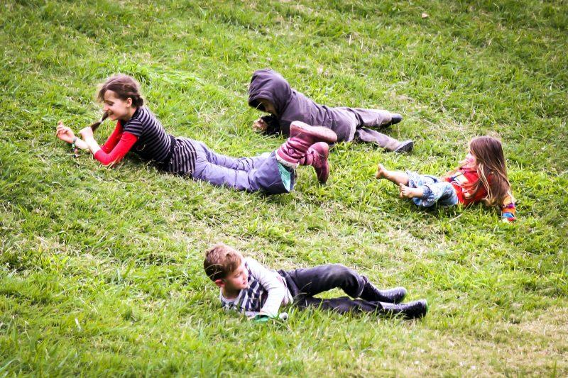 Kids rolling down hill