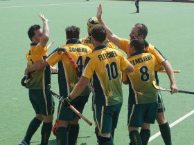 Australia celebrate a goal at the 2018 Masters World Cup