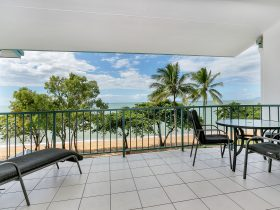 Large private balcony opening to the sea breezes.