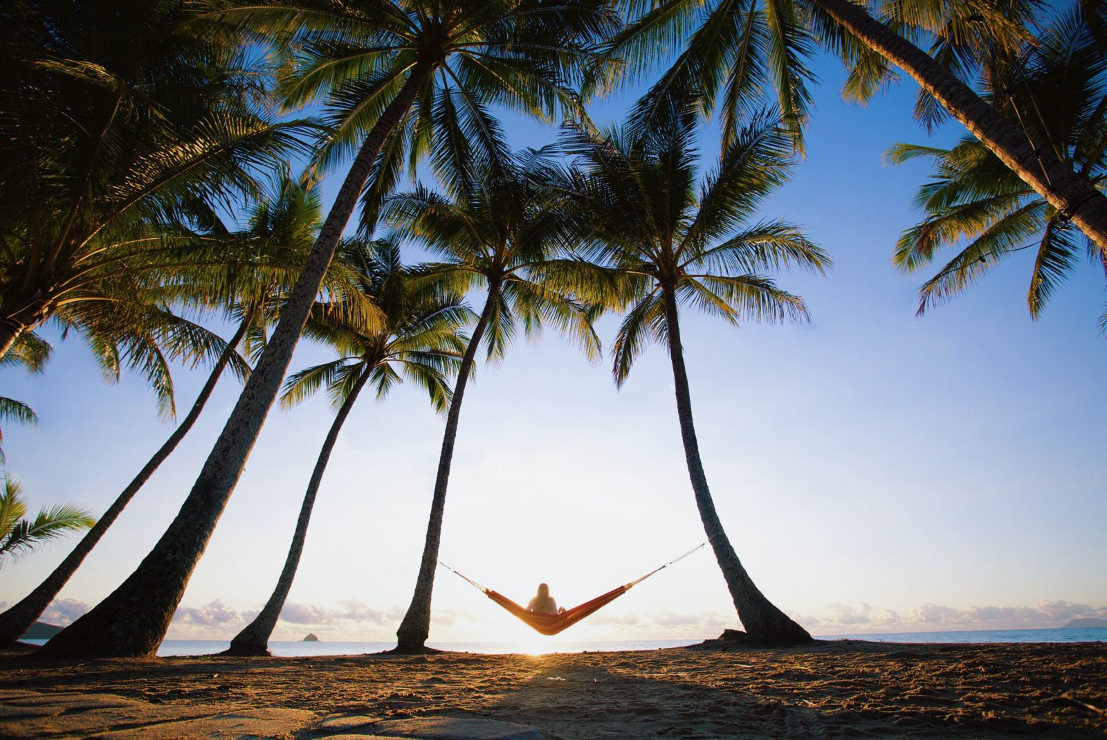 Sunrise hammock swinging at Palm Cove