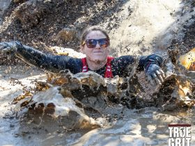 Girl splashes in mud on course