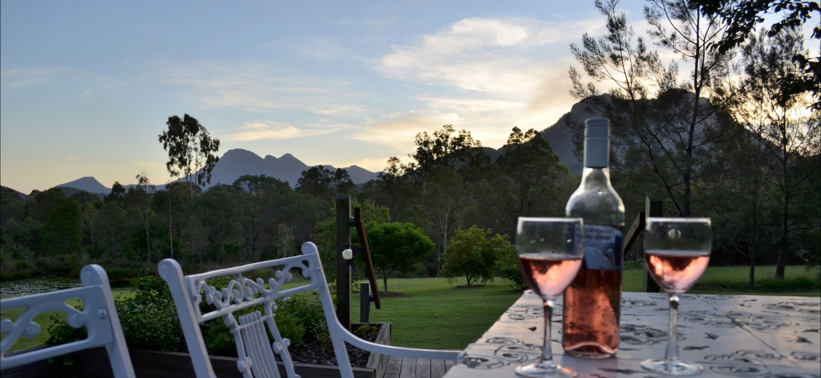 Enjoy a wine whilst taking in the view of Mt Barney and Mt Maroon