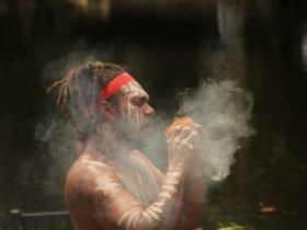 Jellurgal Performer showing how they make fire.
