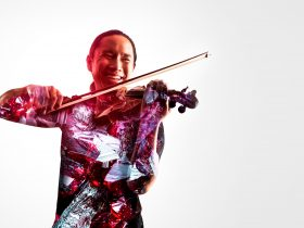 Violin player superimposed with images of gems
