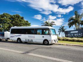 bus entering airlie beach