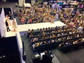 Large amount of people watching the fashion parades at Your Local Wedding Guide Gold Coast Expo