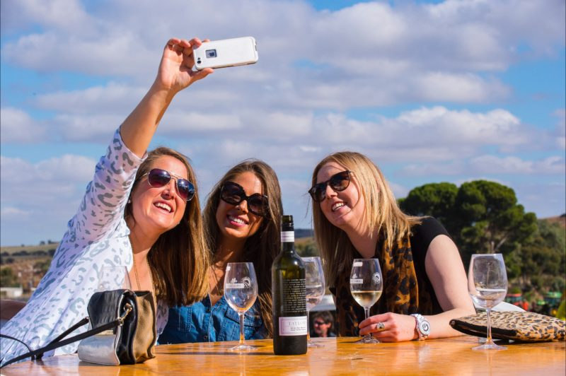3 Ladies enjoying a glass of wine taking a selfie at the Clare Valley Gourmet Weekend