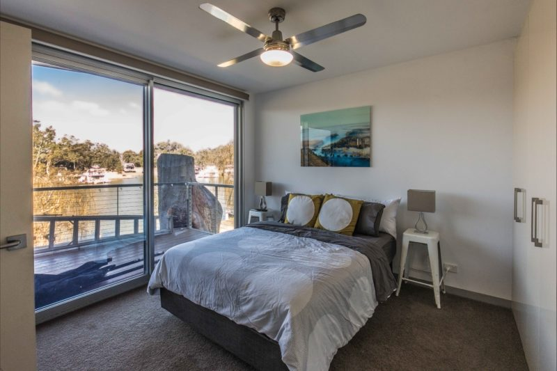 Master bedroom with hidden ensuite and river views