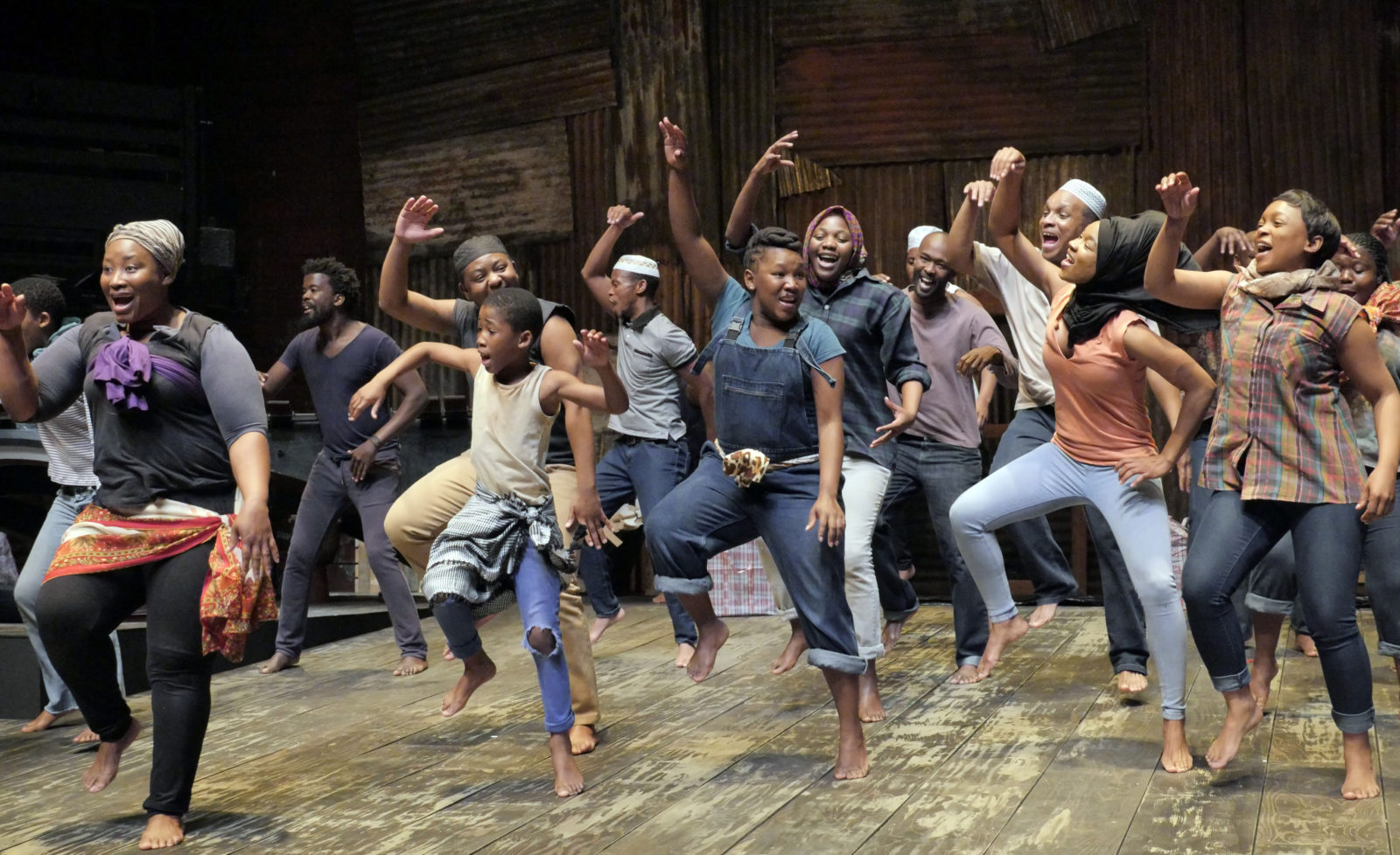 Cast of A Man of Good Hope are singing and dancing