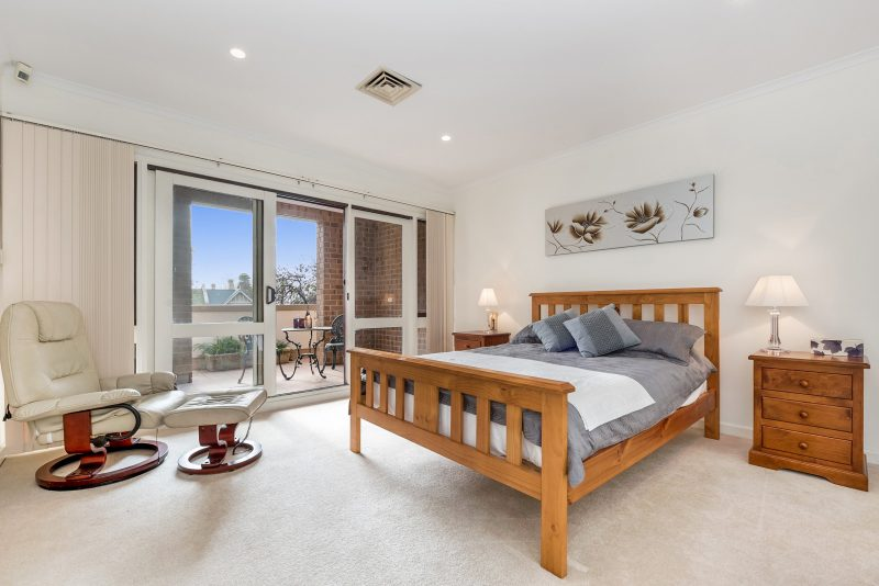 Spacious main bedroom with walk in wardrobe, balcony and luxurious onsuite bathroom