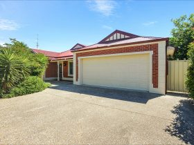 All Seasons' Port Elliot Holiday House Frontage with large double garage