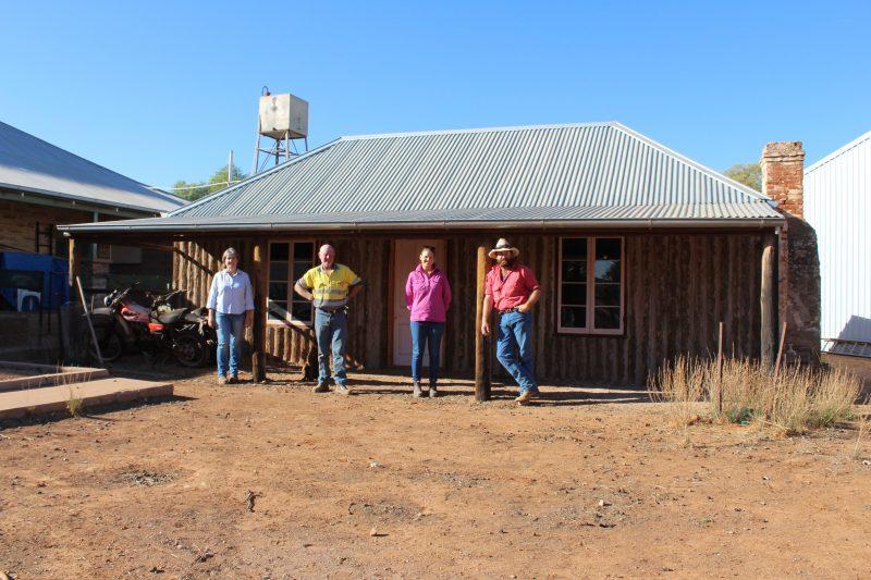 Sally, David, Keziah and John Henery, Generation 5 & 6, in front of original Alpana cottage.