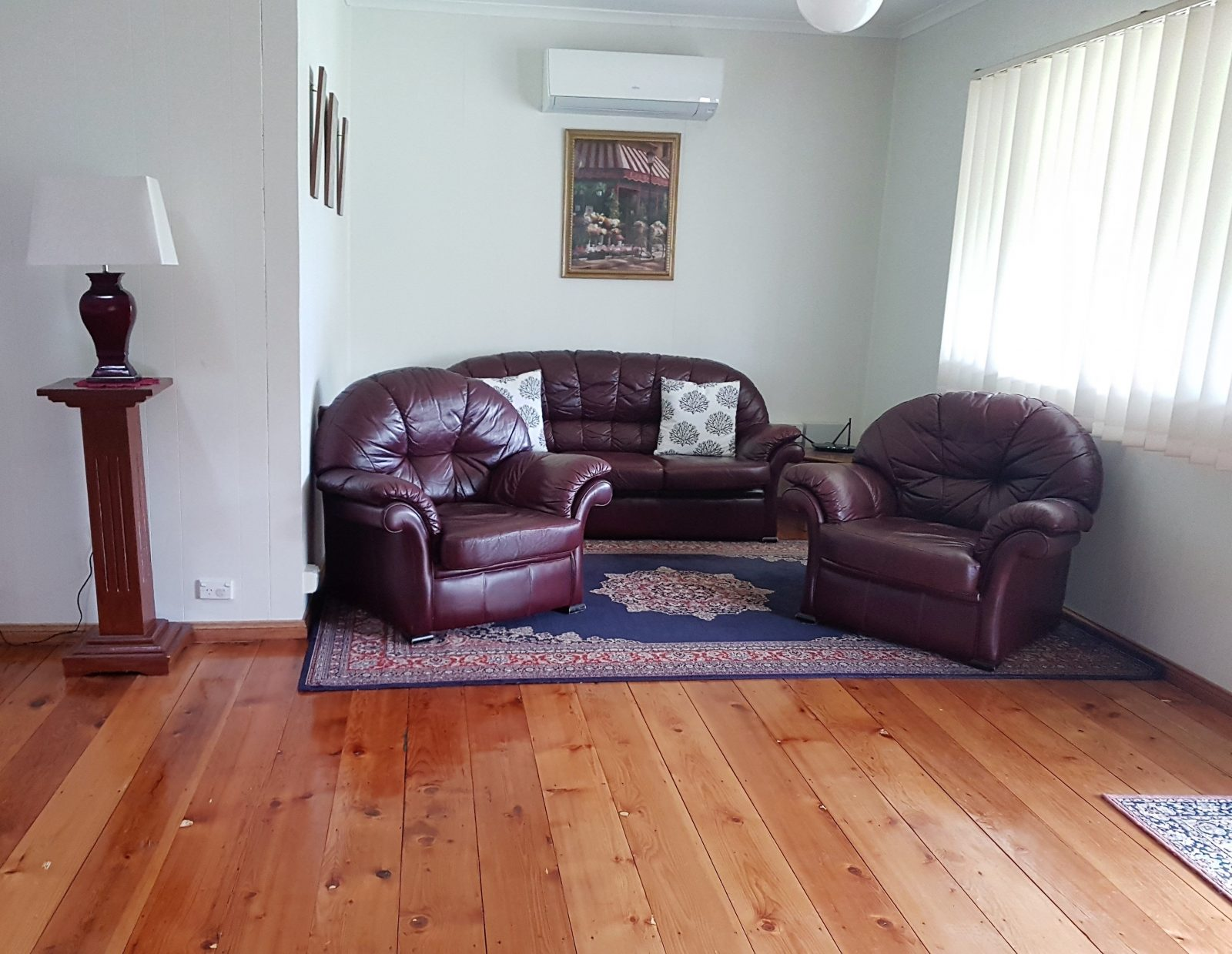 Open living area with airconditioner in Angas Cottage Strathalbyn