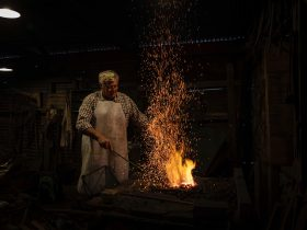 Angaston blacksmith stoking the coals