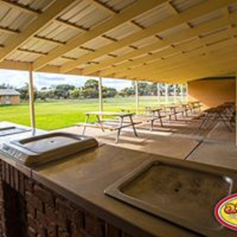 Outdoor alfresco area with BBQ overlooking lawned play areas.