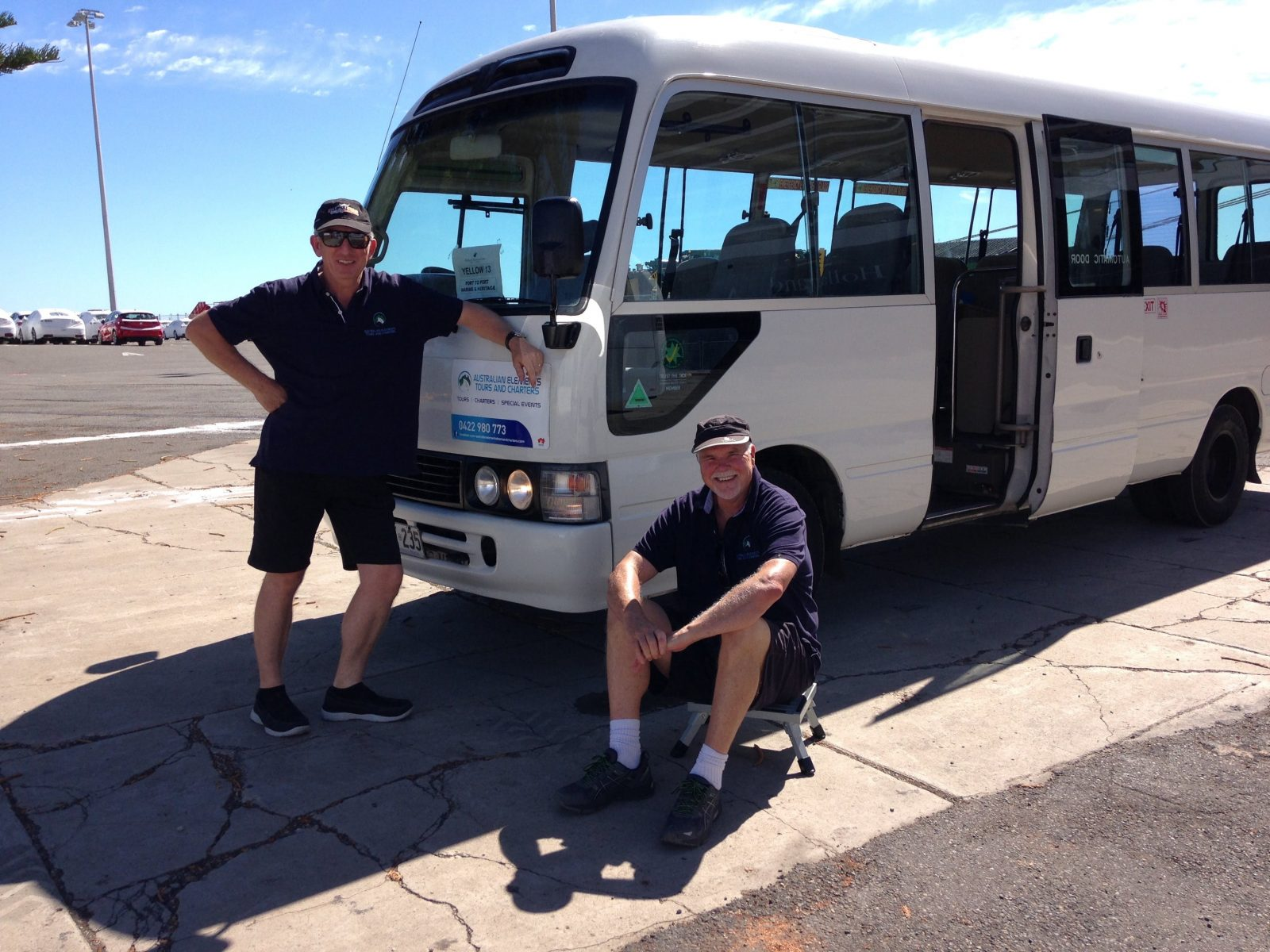 Bus and Company owner David Moss standing on the left with trainee driver Kym