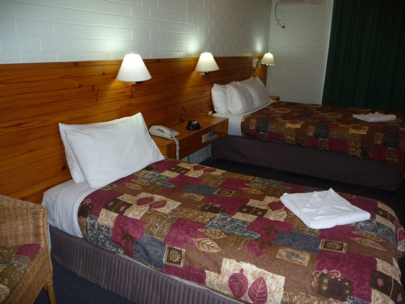 spacious room with queen bed and single bed