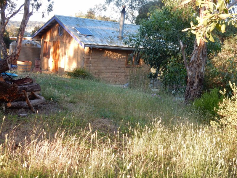 Mudbrick Cabin surrounded by the Australian bush