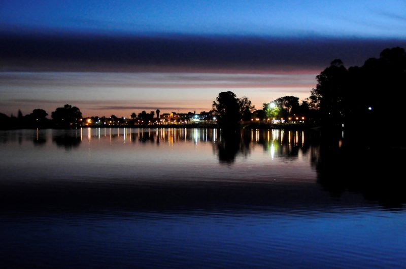 View of the Renmark Township at night from the houseboat deck