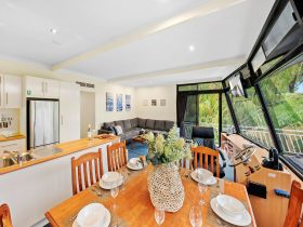 Spacious kitchen, dining and living area on Moving Waters