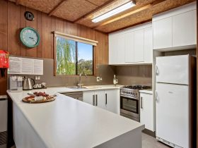 Fully equipped kitchen with large fridge, dishwasher and coffee machine