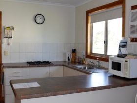 lovely kitchen layout. Stovetop, microwave, Bar fridge, kettle, toaster, cutlery etc