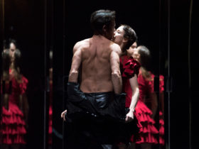 Image of dancers caught in an intimate embrace