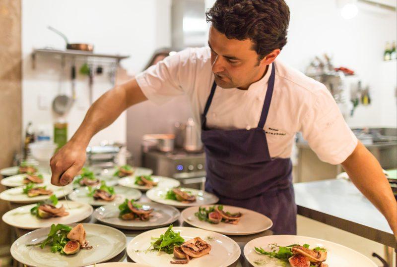 Chef Matteo preparing beautiful South Australian calamari, local fig & rocket salad for a private dinner