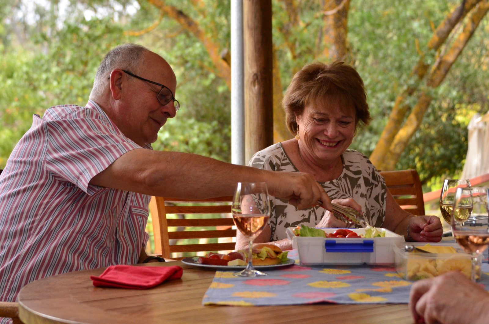 A couple enjoying gourmet picnic on their Clare Valley Food and Wine Tour