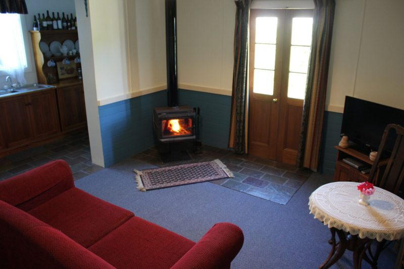sitting room with slow combustion log fire