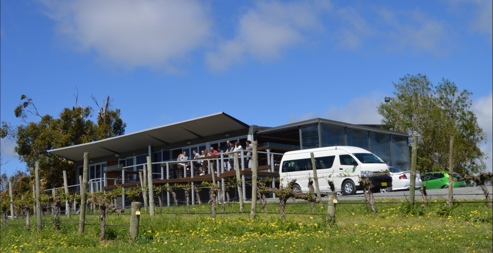 Des's Minibus with a 13 seat vehicle in front of an Adelaide Hills winery.