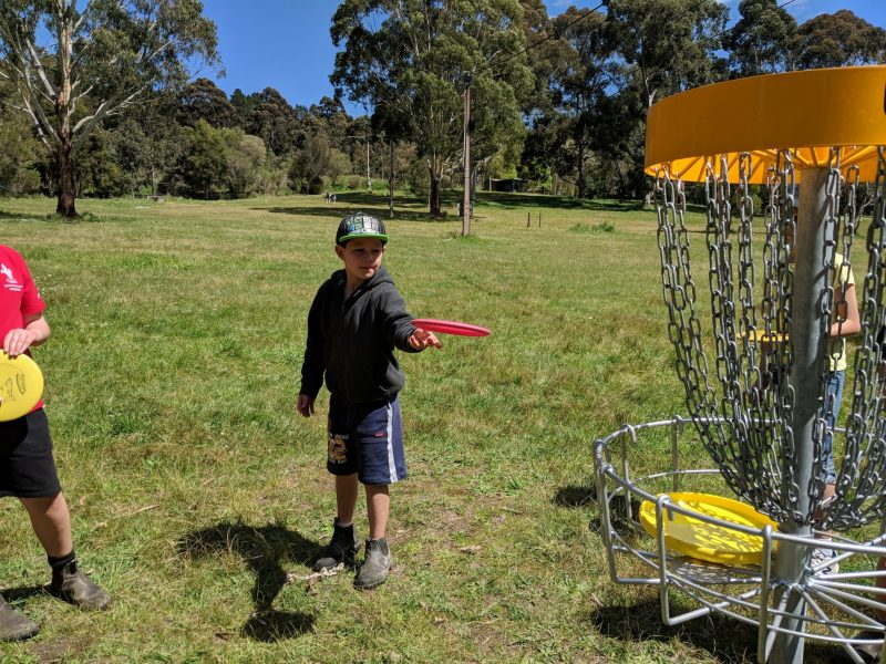Boy playing Disc Golf