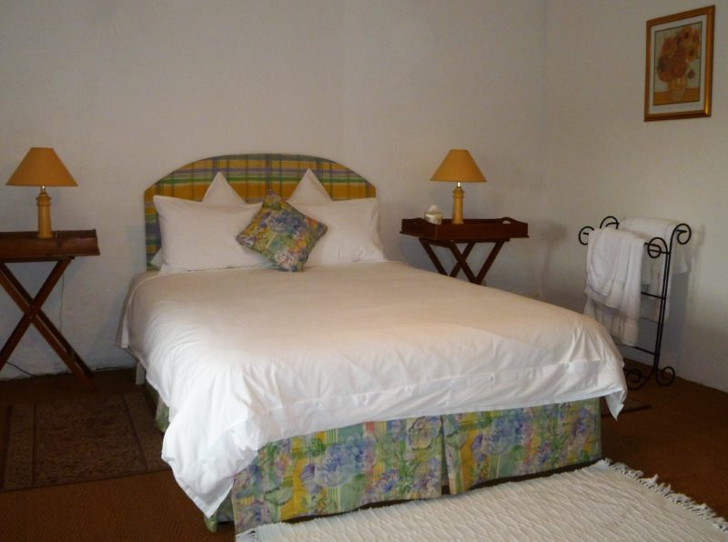 Spacious queen size bedroom with quality white linen