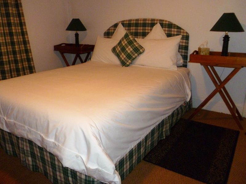 Spacious queen size bedroom with quality linen