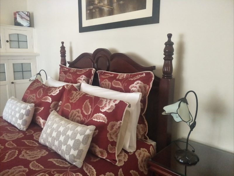 The romantic, traditional large front bedroom is elegant , with lovely mahogany furniture throughout